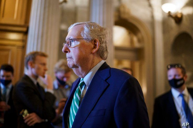 Senate Minority Leader Mitch McConnell, R-Ky., walks past the chamber as the Senate advances to formally begin debate on a…