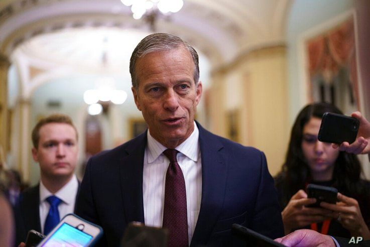 Senate Minority Whip John Thune, R-S.D., speaks to reporters just off the Senate floor as a bipartisan group of lawmakers…